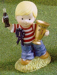 Coca-Cola Kids Boy With Trophy And Blue Ribbon Figurine